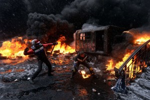 A protestor throws a molotov cocktail at riot police in the centre of Kiev on January 22, 2014. Ukrainian police today stormed protesters' barricades in Kiev as violent clashes erupted and activists said that one person had been shot dead by the security forces. Total of two activists shot dead during clashing. The move by police increased tensions to a new peak after two months of protests over President Viktor Yanukovych's failure to sign a deal for closer ties with the EU. AFP PHOTO/ VASILY MAXIMOVVASILY MAXIMOV/AFP/Getty Images