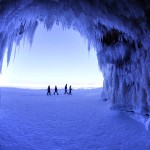 In this Feb. 2, 2014 photo, people walk past a cave at Apostle Islands National Lakeshore in northern Wisconsin, transformed into a dazzling display of ice sculptures by the arctic siege gripping the Upper Midwest. The caves are usually are accessible only by water, but Lake Superior's rock-solid ice cover is letting people walk to them for the first time since 2009.  (AP Photo/The Minneapolis Star Tribune, Brian Peterson) MANDATORY CREDIT; ST. PAUL PIONEER PRESS OUT; MAGS OUT; TWIN CITIES TV OUT