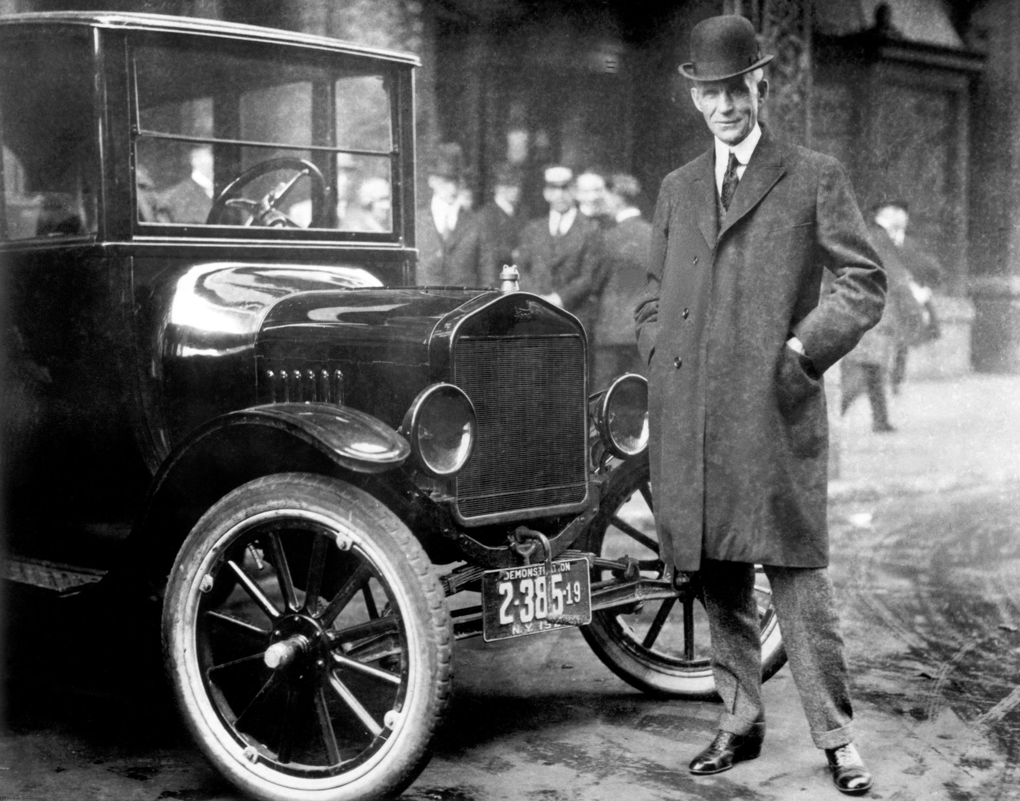 While other auto makers wanted to design luxury cars Henry Ford designed a car that anyone could afford. Here he is standing by that very car. From the collections of The Henry Ford and Ford Motor Company.