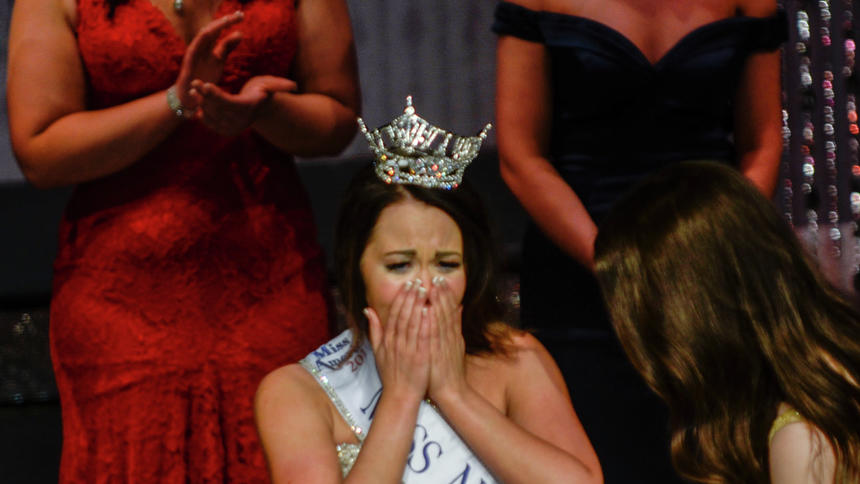 Cara Mund, center, was crowned Miss North Dakota on Saturday night in Williston. This was Mund's fourth year competing for the crown. She will go on to represent North Dakota in the Miss America Scholarship Pageant this fall.