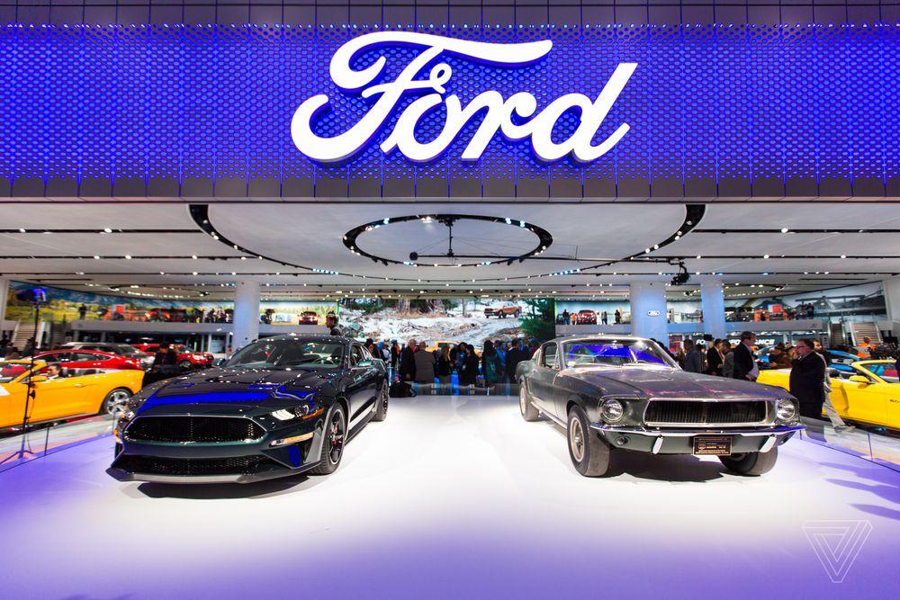 The new Mustang Bullitt next to the Mustang from Bullitt that Steve McQueen actually drove.