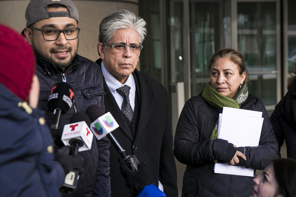 Luz Maria Garcia looks on as her son, 29-year-old Christian Gomez Garcia, and his attorney, Juan Soliz, talk to reporters outside the Chicago Field Office after Gomez Garcia was released from an ICE detention center Thursday morning, Feb. 1, 2018. Gomez Garcia, a DACA recipient, was taken into custody at Cook County Circuit Court in Skokie and detained for three nights. | Ashlee Rezin/Sun-Times