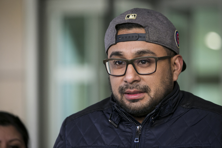 Christian Gomez Garcia, 29, talks to reporters outside the Chicago Field Office after he was released from an ICE detention center Thursday morning, Feb. 1, 2018. Gomez Garcia, a DACA recipient, was taken into custody at Cook County Circuit Court in Skokie and detained for three nights. | Ashlee Rezin/Sun-Times