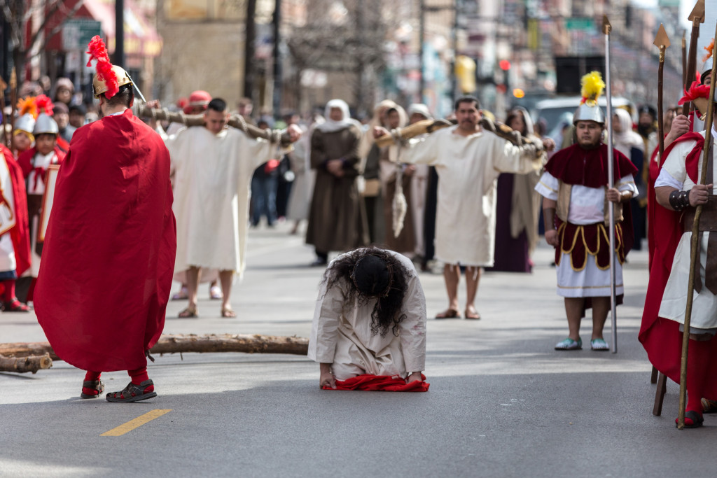Jesus falls and is lashed.   Erin Brown/Sun-Times