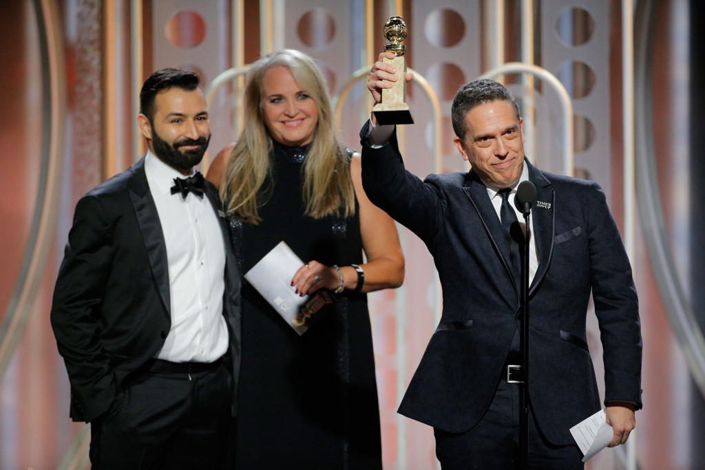 """BEVERLY HILLS, CA - JANUARY 07:  In this handout photo provided by NBCUniversal, Director Lee Unkrich accepts the award for Best Animated Film for """"Coco""""  during the 75th Annual Golden Globe Awards at The Beverly Hilton Hotel on January 7, 2018 in Beverly Hills, California.  (Photo by Paul Drinkwater/NBCUniversal via Getty Images)"""